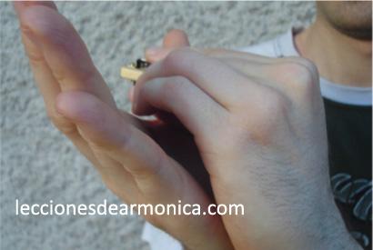 hold the harmonica step 4